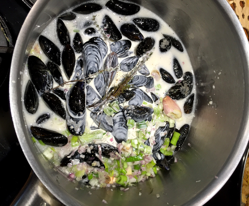 mussels cooking in cream